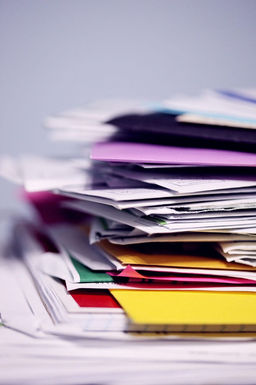 Pile of mail waiting to be sorted and shredded.