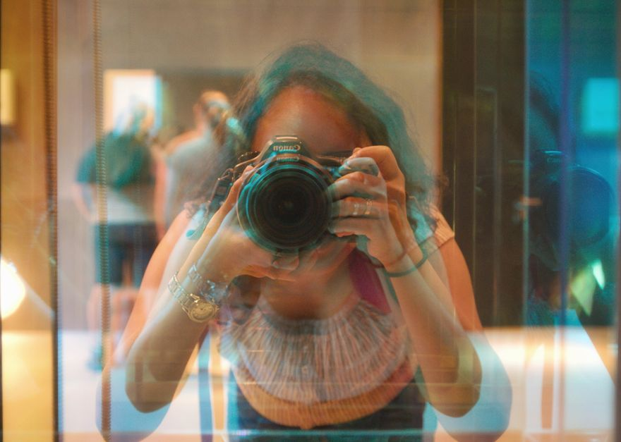 woman-hold-camera-in-front-of-a-prism-mirror.jpeg