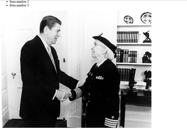 Grace Hopper and Ronald Regan shaking hands at the White House